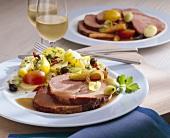 Surbraten (corned pork) with colourful potato salad