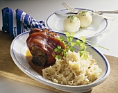 Roast pork knuckle with dumplings and sauerkraut