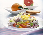 Fish salad with citrus fruit and yoghurt dressing