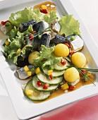 Salad with Bismarck herring, cucumber and potatoes