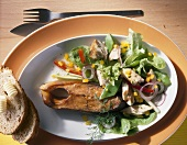 Smoked carp cutlet with salad