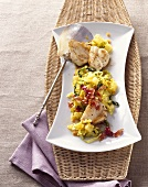 Monkfish medallions on creamed curried savoy