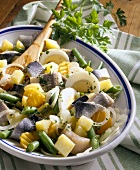 Herring salad with potatoes, beans, carrots and egg