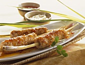 Seafood kebabs on lemon grass stalks (Asia)
