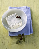 Robiola (fresh cheese from Italy) in white bowl