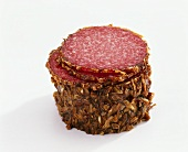 Salami coated in fried onions