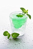 Ice glass with mint liqueur