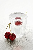 Ice glass with schnapps and cherries