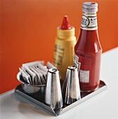 Ketchup, mustard, salt and pepper