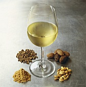 Glass of white wine surrounded by spices