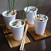 Rice noodles with chicken in plastic cups (Asia)