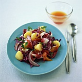 Warm red cabbage salad with potatoes and oranges