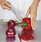 Cutting into a red pepper