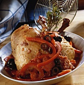 Coq au vin with peppers and olives