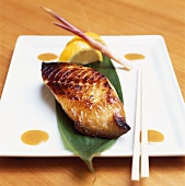 Cod fillet with miso paste on banana leaf (Japan)