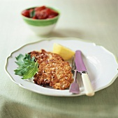 Breaded veal escalope with salt and lemon