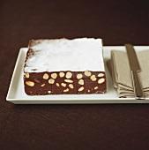 Chocolate nut cake with icing sugar