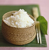 Steamed rice in a bamboo basket