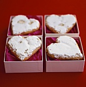 Heart-shaped biscuits with icing sugar to give as gifts