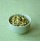 Cardamom pods in green bowl