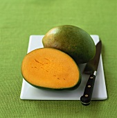 Mango, whole and half