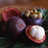 Mangosteens, one halved