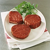 Three beef fillet steaks on plate