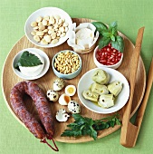 Assorted salad ingredients on wooden platter