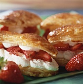 Puff pastries filled with strawberries and cream