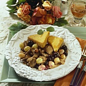 Sweet and sour pork with grapes and polenta triangles