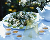 Pear truffles, tea and wreath of pear blossom on table