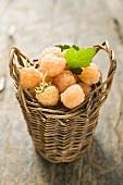 Yellow raspberries in small basket