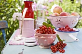 Peaches, berries and jam jars on garden table