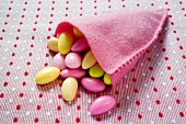 Sugared almonds in pink felt bag