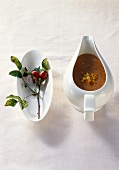 Savoury rose hip sauce in sauce-boat