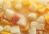 Frozen fruit in block of ice (full-frame)