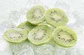 Frozen kiwi fruit slices on ice cubes