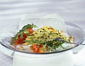 Vegetable frittata, garnished with rocket and tomatoes