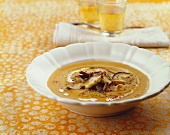 Sweet potato soup with fried mushrooms