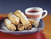 Marzipan chocolate rolls with icing sugar