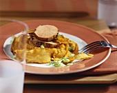 Peppered pork fillet on mashed sweet potato