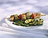Turkey and artichoke kebab with courgettes