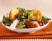 Tomato and rocket salad with fried cheese dumplings