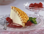 Piece of Charlotte Royal with raspberry sauce