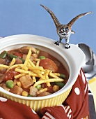 Sausage and vegetable stew with chips for children
