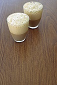Two glasses of coffee with milk froth