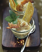 Potato and scampi soup with basil and toasted bread