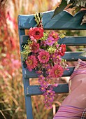 Small bunch of zinnias and asters on chair back