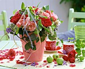Roses, clematis and borage in pink vase (summery)