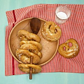 Pretzels on wooden plate and wooden spoon